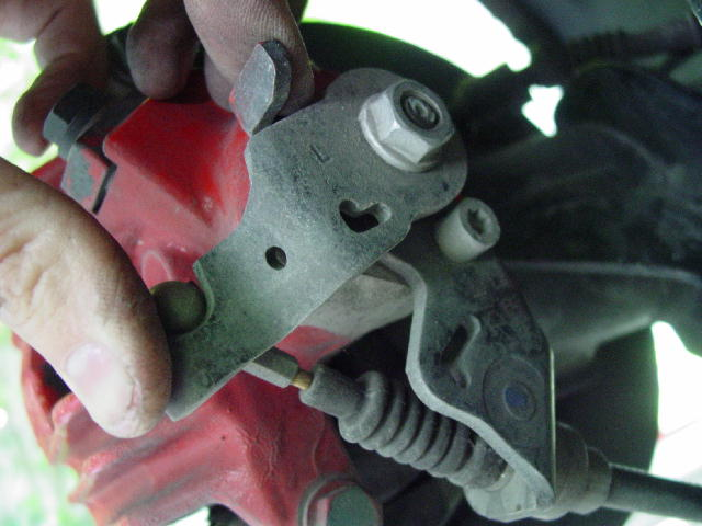 """How To"" Replace your Pads and Rotors (Front and Rear)-disconnecting-parking-brake-cable.jpg"