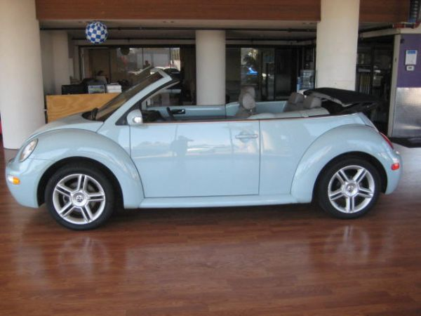 Honey badger drives a 2004 light blue turbo convertible-mybug.jpg