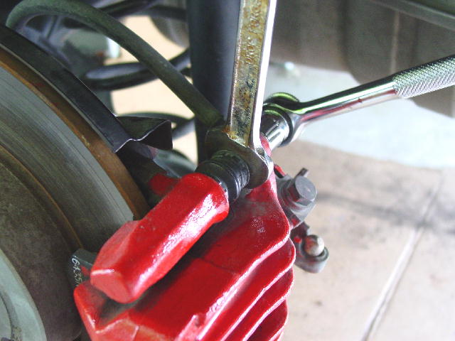 """How To"" Replace your Pads and Rotors (Front and Rear)-removing-self-locking-bolts-rear.jpg"