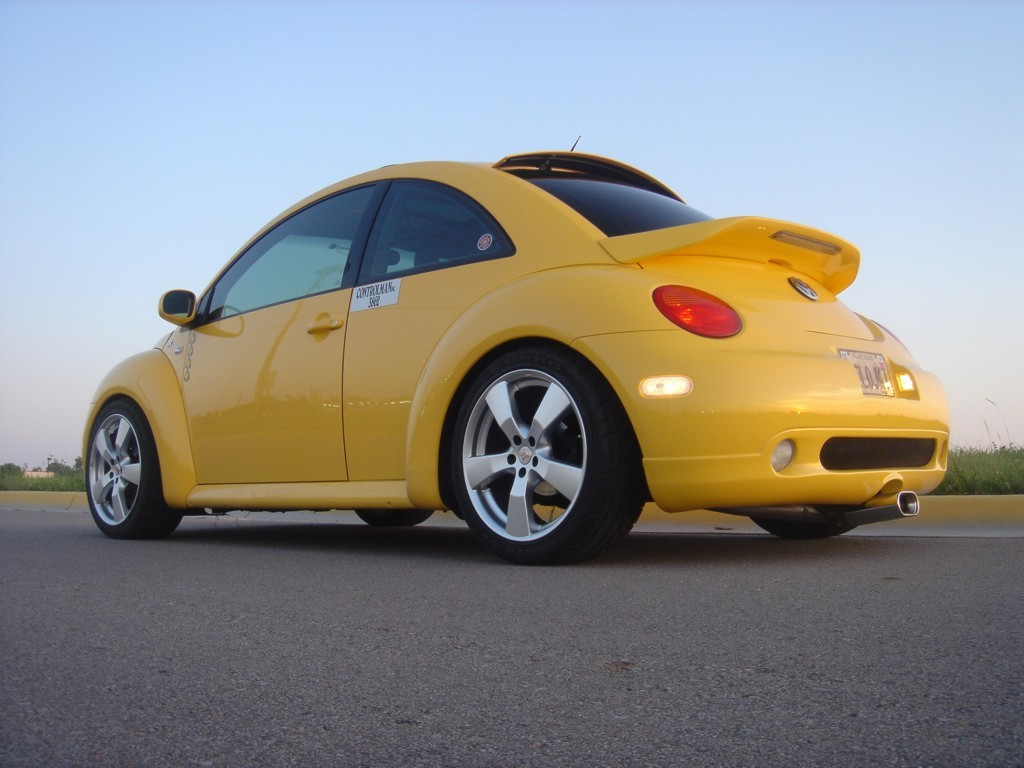 YELOJKT- 2000 reflex yellow 1.8T GLS-yelojkt-goddard-ks-caractere-kit-done-rear-3-4-view.jpg